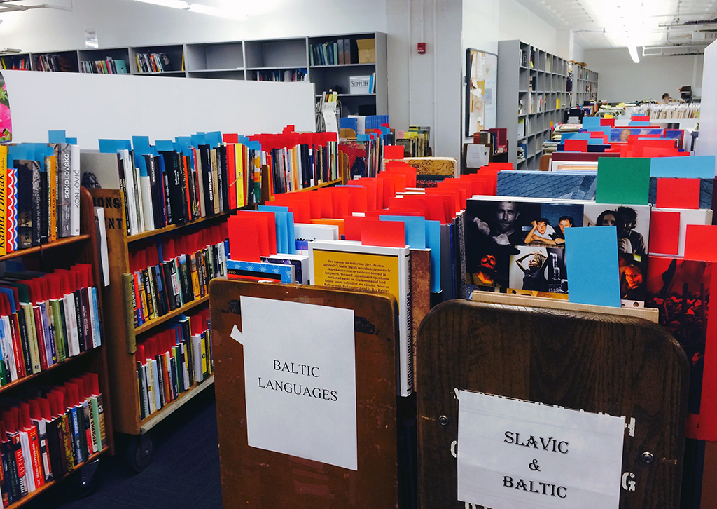 Books await routing at BookOps | Photo by Shannon Mattern