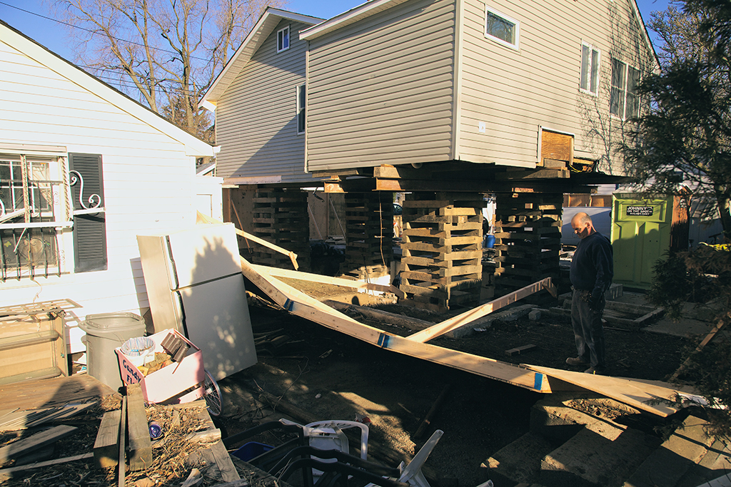 """The elevation of a detached house in the flood plain in Staten Island, in 2013.   Photo by Sunghwan Yoon, via <a href=""""https://www.flickr.com/photos/jacopast/8442655853/in/album-72157632683483765/"""">Flickr</a>."""