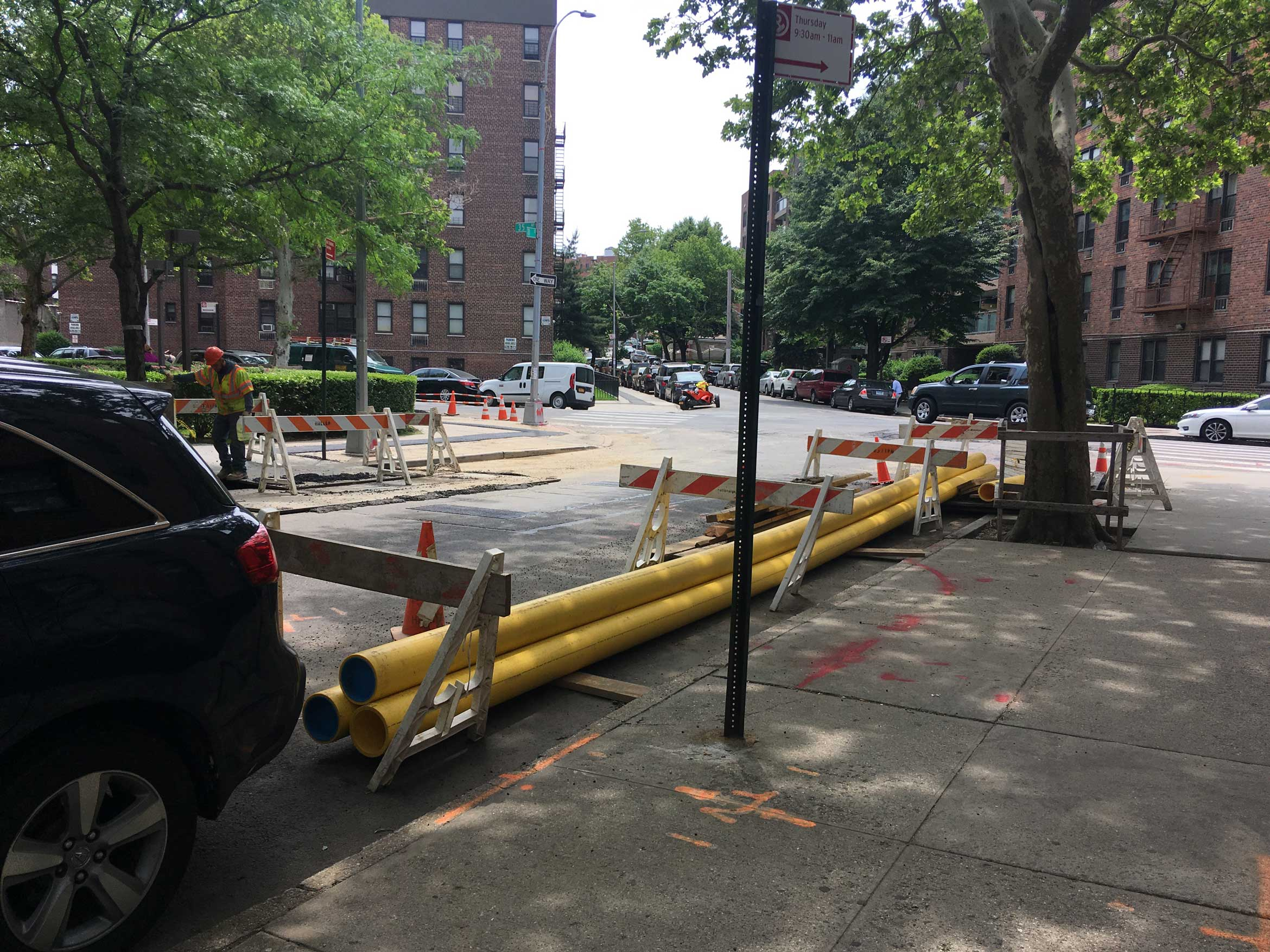 Plastic pipe ready for gas line replacement in Queens.