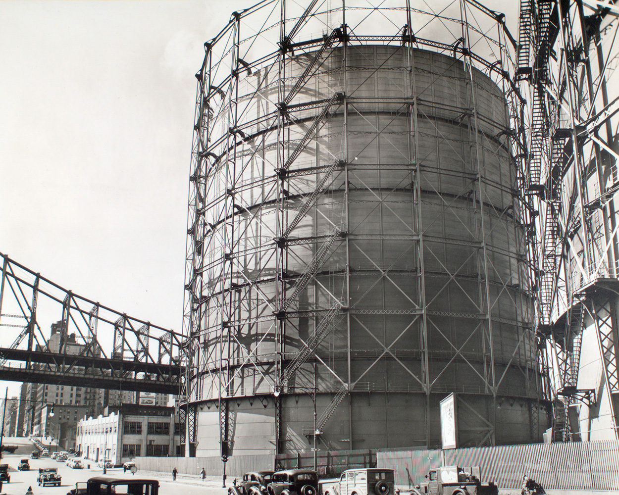 """Gas holder, York Avenue and 62nd Street, 1935. Photo by Bernice Abbott via <a href=""""https://digitalcollections.nypl.org/items/510d47d9-4f4b-a3d9-e040-e00a18064a99"""">NYPL Digital Collections</a>"""