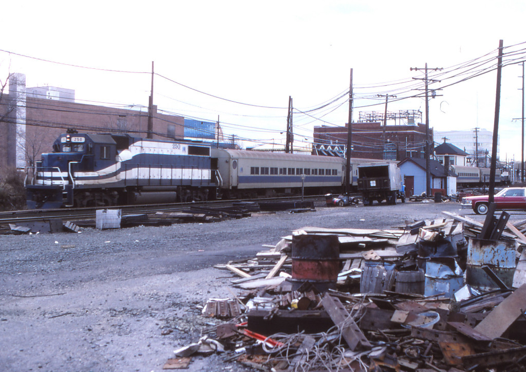 An LIRR train passes through Mineola, New York in the 1970s. Photo by Tom Beckett